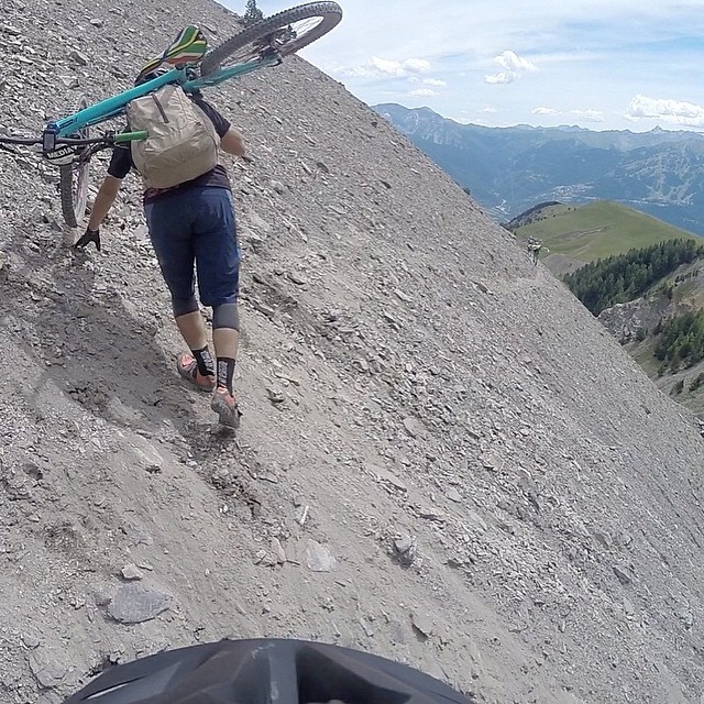 Dirty tip - if you're going to follow someone along the traverse of death, pick an experienced campaigner... @garyperkin getting it done on Day 1 of #MavicTP2015, while I attempt to not look down into the vortex #gladihadenduroshoes #sofuckenendurorightnow #prepareforthegoproflashbacks #EuroEnduro #justdowhatgarydoes #dirtynomad #longwaydown